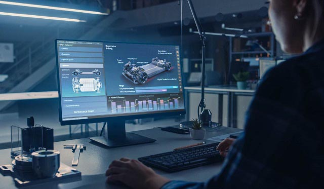 A woman designs a car chassis on a desktop PC, a major application for SK hynix client NVMe SSD